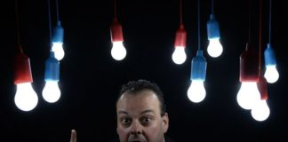 man shows light bulbs